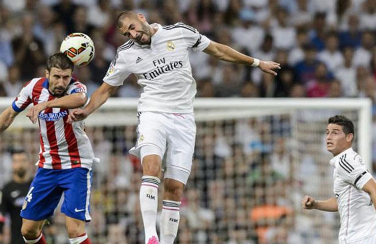 صراع فى الهواء بين بنزيمة ومدافع اتلتيكو مدريد