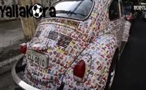 مشجع يضع 1500 صورة للاعبين على سيارته