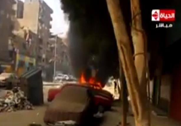 محلب يدعو صاحب التاكسى المحترق في المطرية خلال احداث الشغب الى استلام تاكسى اخر