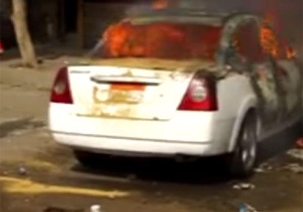 احتراق سيارة أجرة أثناء اشتباكات المطرية في ذكرى الثورة