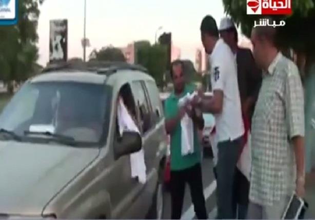توزيع أكثر من 5 آلاف تيشرت وكاب تحمل شعار قناة السويس الجديدة