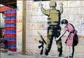 """فلسطيني تعرض للاحتيال في بيع إحدى لوحات """"بانكسي"""" في غزة"""