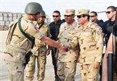 17 صورة ترصد عودة السيسي للزي العسكري (فيديو)