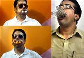 هندي يضع 1001 ماصة في فمه..ويسجل رقم قياسي