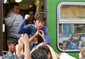 بالصور و الفيديو- اشتباكات بين اللاجئين السوريين وشرطة بودابيست