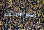 بالصور.. نجوم كرة وجماهير ألمانيا للاجئين: