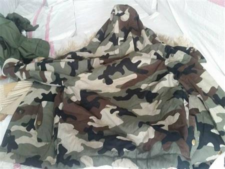 بالصور- جمارك الإسكندرية تُحبط تهريب ملابس عسكرية