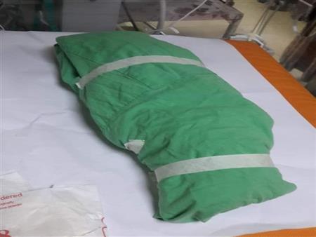 """دفنوه جوار شقيقته..  أم فقدت جنينها """"مرتين"""" بعد القصف الإسرائيلي على غزة"""