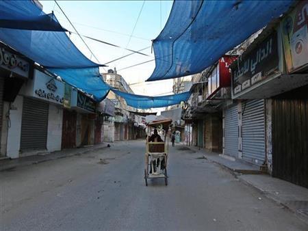 """إضراب في قطاع غزة احتجاجا على """"ورشة البحرين"""""""