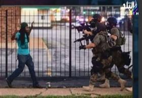 لحظة وفاة مايكل براون وسقوطه على الارض وضرب وسحل المواطنين فى امريكا