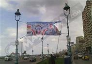بالصور.. إزالة لافتات ''مصرنا بلا عنف'' من شوارع الإسكندرية
