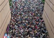 بالصور.. 10 آلاف صيني يتقدمون لوظيفة واحدة!
