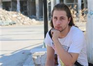 بالصور- من الثانوية للفوز بجائزة تصوير عالمية.. قصة أمير الحلبي مع الثورة السورية