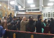 بالصور- المئات يشيعون شهيدي الإرهاب من كنيسة الملاك ميخائيل في السويس