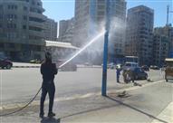 """بالصور- غسل أعمدة إنارة كورنيش الإسكندرية بالمياه.. ورواد """"فيس بوك"""": """"ربنا يستر"""""""