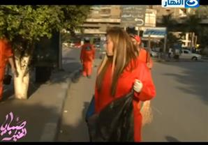 ريهام سعيد ترتدي بدلة عاملي النظافة.. وتهتف ''تحيا مصر''