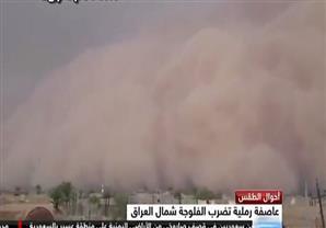 عاصفة رملية تضرب الفلوجة بالعراق مما أدي إلى حالات إختناق بين السكان