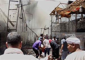 """المعاينة: النيران التهمت 70 باكية و5 محلات و4 شقق و7 مصابين بحريق """"سوق إمبابة"""""""