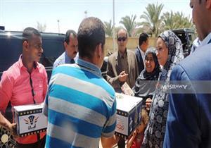 """أمن الوادي الجديد يوزع 1000 كرتونة رمضان على """"الأولى بالرعاية"""""""