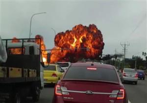 بالفيديو.. أسلاك كهرباء بشوارع أمريكا تتسبب في انفجار طائرة