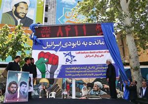 """""""8411 على زوال إسرائيل"""".. ماذا تعني اللافتة الإيرانية في مظاهرات """"القدس""""؟"""