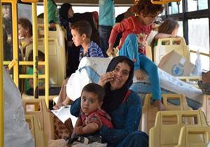 صورة وخبر: حلب.. أم وطفل في رحلة نزوح