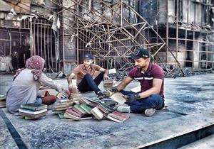 """بالصور- مصراوي يسرد حكاية 17 شابا أنقذوا """"مكتبة الموصل"""" من دمار داعش"""