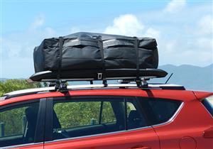 خبراء السيارات يوضحون الطريقة الصحيحة لوضع الحقائب أعلى السيارة