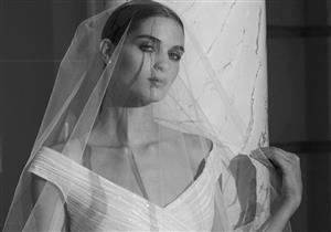 بالصور- إيلي صعب يُزين الخطوط الهندسية برقة الأزهار في مجموعة فساتين زفاف خريف 2019
