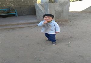 """بالصور- بطولة أمين شرطة.. """"كميل"""" ينقذ طفلا سقط من الدور الثالث في أسيوط"""