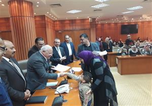 """بالصور.. توزيع 116 شهادة """"أمان"""" على الموظفين في بورسعيد"""