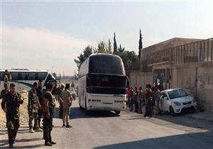 حافلات تدخل إلى أحياء جنوب دمشق لنقل مسلحي داعش إلى البادية