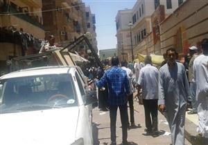 بالصور- رفع 240 حالة إشغال طريق في حملة بأسوان