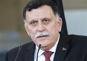 السراج يجدد رفض ليبيا توطين المهاجرين.. ويجدد الطلب بدعم بريطانيا لبلاده