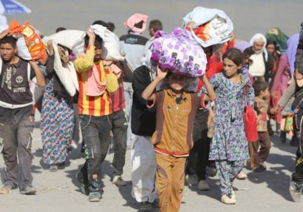 تحرير امرأة وابنها من قبضة  داعش  في سوريا...مصراوى