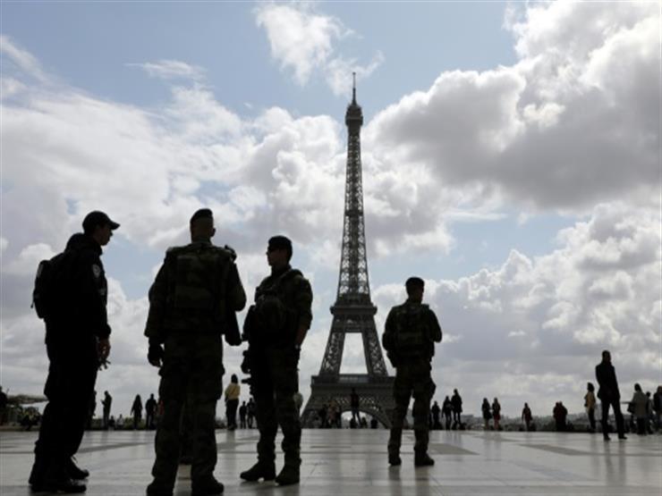 اشتباكات بين محتجين والشرطة في العيد الوطني الفرنسي