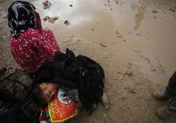 """صورة وخبر: نازحو الموصل يصلون إلى """"حمام العليل"""""""