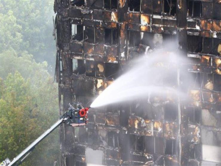 بريطانيون يلتزمون الصمت دقيقة حدادا على ضحايا برج جرينفيل