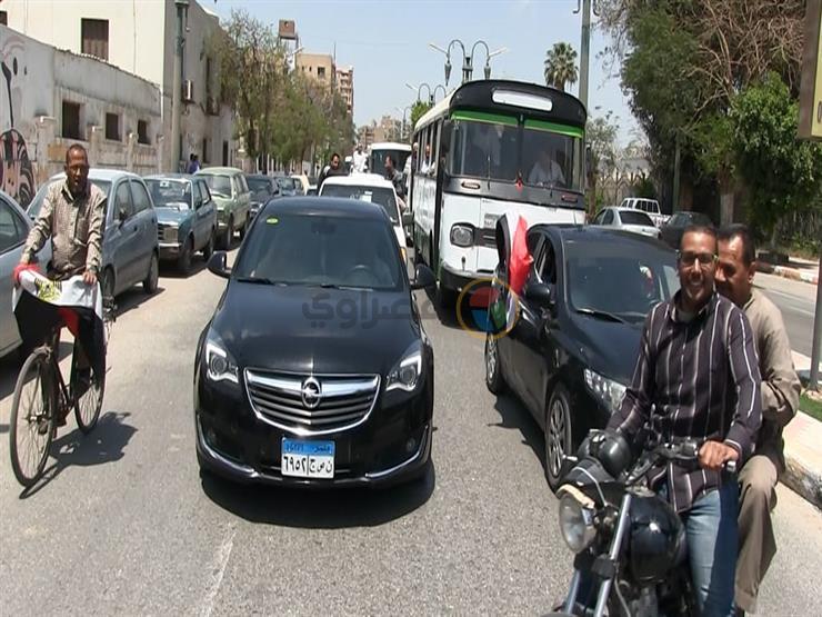 مسيرة بالسيارات للعاملين في مطاحن مصر الوسطى بالمنيا للمشاركة في الاستفتاء