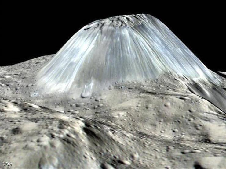 """""""ناسا"""" تكشف صورة لجبل على كويكب قزم: لم ترَ البشرية مثله من قبل"""