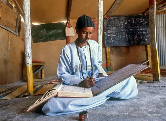 كتابة القرآن على خشب في مرسى علم عام 1983