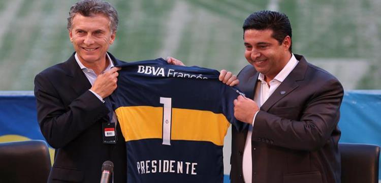 الرئيس الارجنتيني ماكرى على يسار الصورة